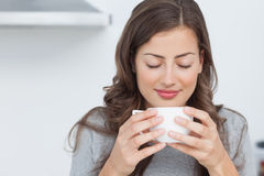 Woman waking with the smells of coffee Stock Images
