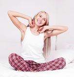Woman waking up Stock Image