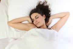 Woman waking up Stock Photography