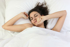 A woman waking up Royalty Free Stock Photos