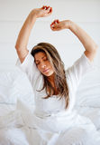 Woman waking up Royalty Free Stock Images