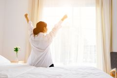 Woman waking up. Royalty Free Stock Photography