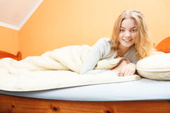 Woman waking up in bed in morning after sleeping Royalty Free Stock Photos