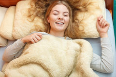 Woman waking up in bed in morning after sleeping Royalty Free Stock Photography