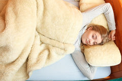 Woman waking up in bed in morning after sleeping Royalty Free Stock Images