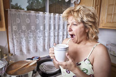 Woman waking up with a coffee. (Yawning Stock Photos