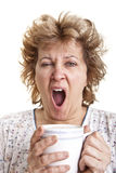 Woman waking up with a coffee. (Yawning Stock Images