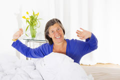 Woman waking up Stock Photos
