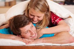 Woman waking up his boyfriend Stock Photos