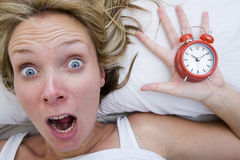 Woman waking up Late Stock Image