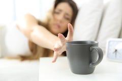 Woman waking up needing coffee royalty free stock photography