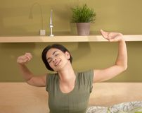 Woman waking up stretching Royalty Free Stock Photo
