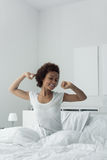 Woman waking up and stretching Stock Photos
