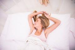 Woman waking up. Stock Photography