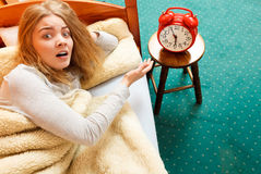 Free Woman Waking Up Turning Off Alarm Clock In Morning Stock Photo - 62523900