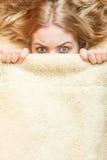 Woman waking up under wool woolen blanket. Stock Photography