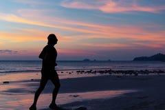 Woman walk along the sea coast Stock Images