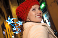 Woman walk around mysterious streets of Christmas Florence. Trip full of inspiration at Christmas time in Florence. smiling modern woman walk around mysterious royalty free stock image