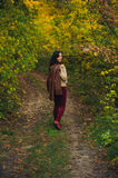 Woman walk in autumn forest Stock Image