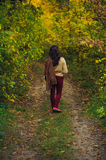Woman walk in autumn forest Royalty Free Stock Photos