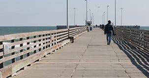 Woman walk away fish pier Gulf of Mexico Texas 4K