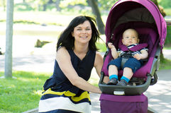 Woman walk baby carriage Royalty Free Stock Photos