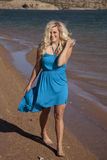 Woman walk beach blue dress Royalty Free Stock Image