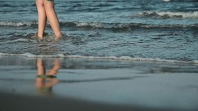 Woman walk at the beach stock footage