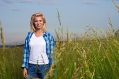 Woman walk in grass field Stock Images