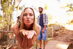 Woman On Walk With Man Blowing Kiss At Camera Stock Image