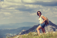 Woman walk on the mountain hill Stock Image