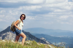 Woman walk on the mountain hill royalty free stock photos