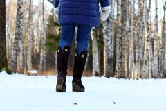 Woman walk park winter snow back. Woman walk in a park winter snow outdoor Stock Photography
