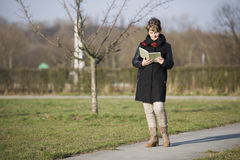 Woman walk and reading side Royalty Free Stock Image