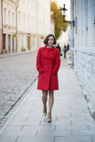Woman walk by street in old city. Young woman walk by street in old city stock photos