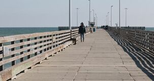 Woman walk towards fish pier Gulf of Mexico Texas 4K