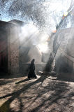 A woman walked Weisang furnace. Tibetan lady walked Weisang furnace at morning Royalty Free Stock Images