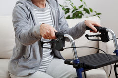 Woman with walker Stock Image