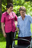 Woman with walker in garden stock images
