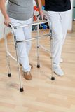 Woman With Walker And Trainer Royalty Free Stock Image