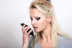 Woman with a walkie-talkie Royalty Free Stock Photos