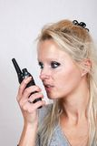 Woman with a walkie-talkie Royalty Free Stock Photography