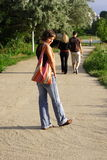 Woman walking. Young beautiful woman walking in the park royalty free stock photography