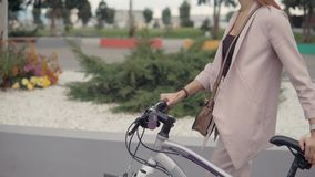 Woman walking alone by bicycle. stock video footage