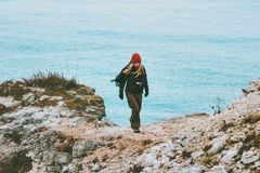 Woman walking alone at cold sea winter beach Travel Lifestyle concept. Outdoor stock photography