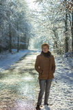 A woman walking alone in the forest Stock Photography