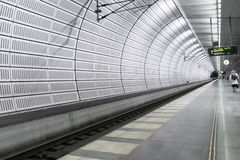 Woman walking alone at a metro station in Malmo, Sweden Stock Photos