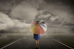 Woman Walking Alone On Rainy Day Royalty Free Stock Photo