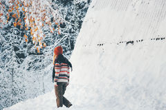 Woman walking alone in winter forest Royalty Free Stock Images