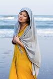 Woman walking along the beach Royalty Free Stock Photo